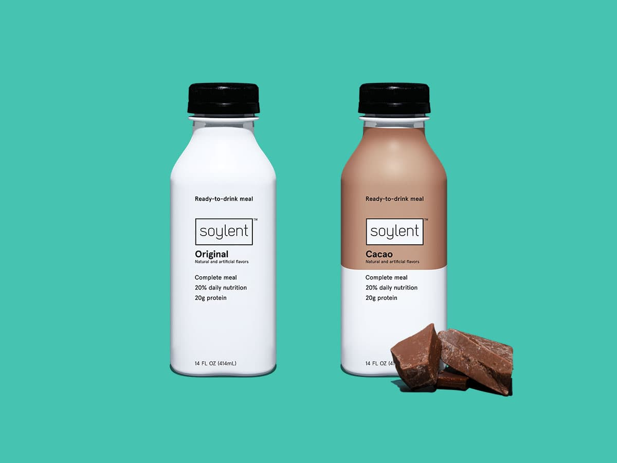 Two bottles of Soylent Drink. Original, Cacao.