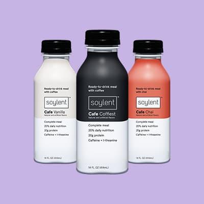 Three bottles of Soylent Cafe.