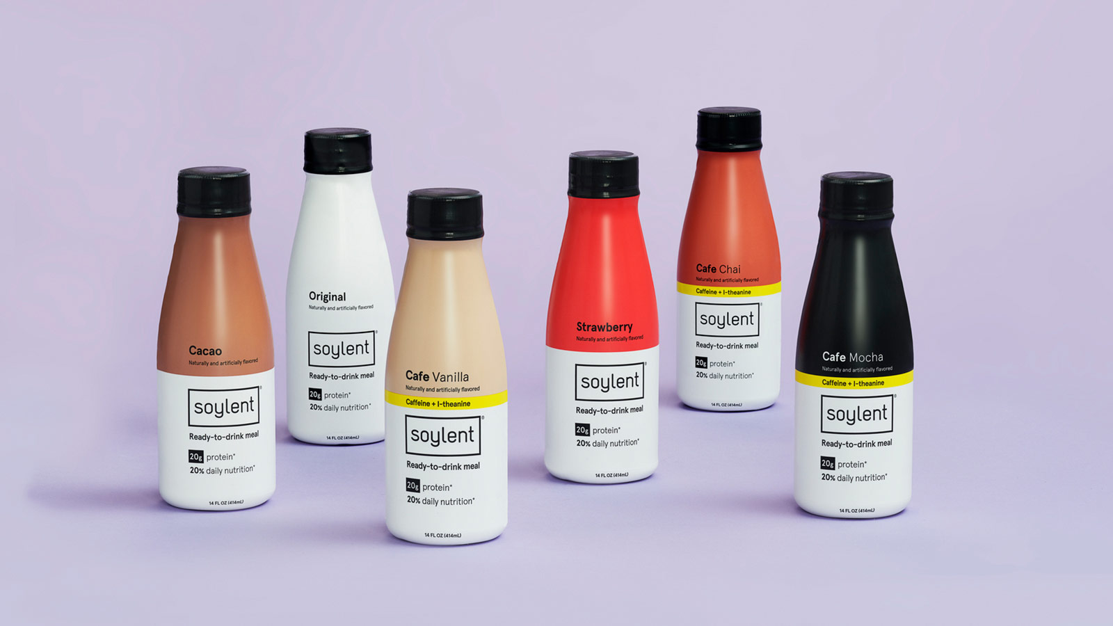 Bottle of Soylent Drink Original on a desk with school supplies.