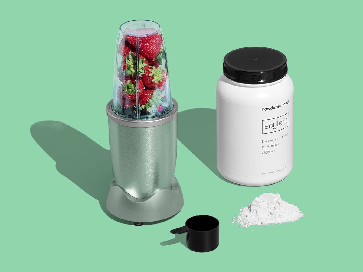 Mixer filled with strawberries next to Soylent Powder Tub and mound of Soylent Powder next to a scoop.